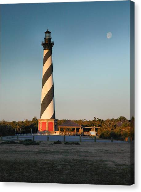 Hatteras Lighthouse And Moon Canvas Print by Steven Ainsworth