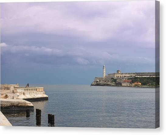 Havana Malecon With Morro Lighthouse And A Lonely, Unrecognizable Person Relaxing By The Sea, Cuba Canvas Print by Smartshots International