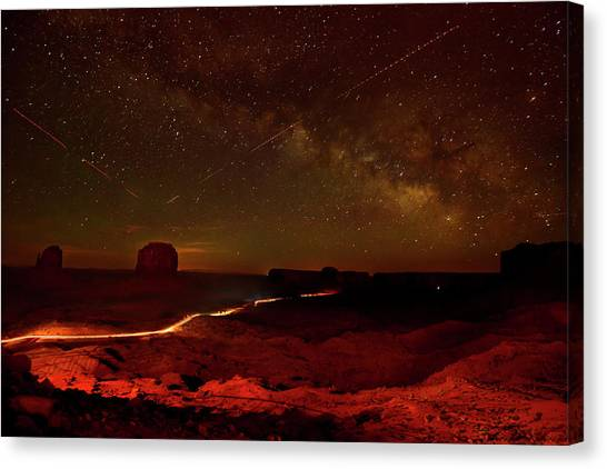Canvas Print - Headlights And Buttes In Monument by Raul Touzon
