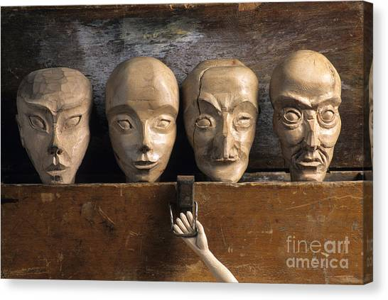 Sculptors Canvas Print - Heads Of Wooden Puppets by Bernard Jaubert