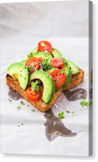 Healthy Toast With Avocado And Cherry Canvas Print by Flavia Morlachetti
