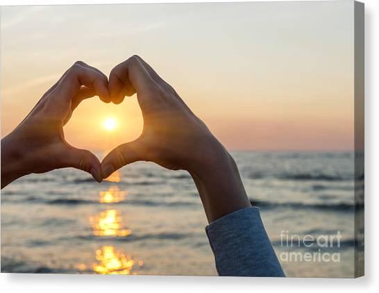 Heart Shape Canvas Print - Heart Shaped Hands Framing Ocean Sunset by Elena Elisseeva