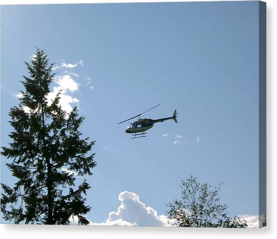 Helicopter Misses Tree Canvas Print by Mavis Reid Nugent