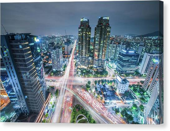High Angle View Of Cityscape Lit Up At Canvas Print by Gangil Gwon / Eyeem