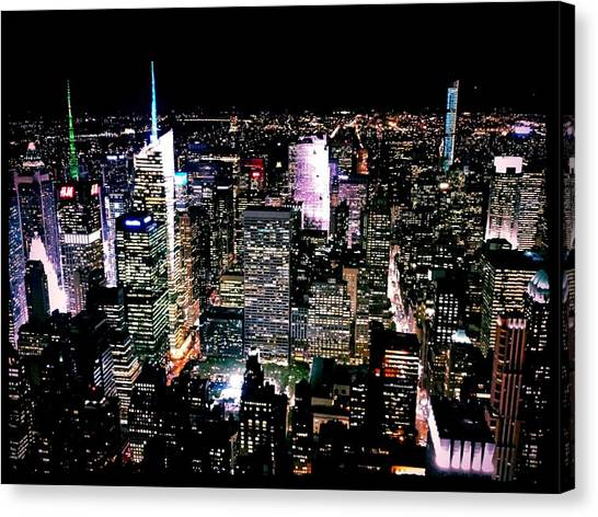 High Angle View Of Cityscape Lit Up At Canvas Print by Paolo Tahalele / Eyeem