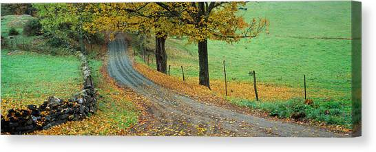 Fallen Leaf Canvas Print - Highway Passing Through A Landscape by Panoramic Images