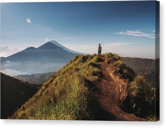 Hiker Staying On Top Of  Mount Batur Canvas Print by Alex Grabchilev / Evgeniya Bakanova
