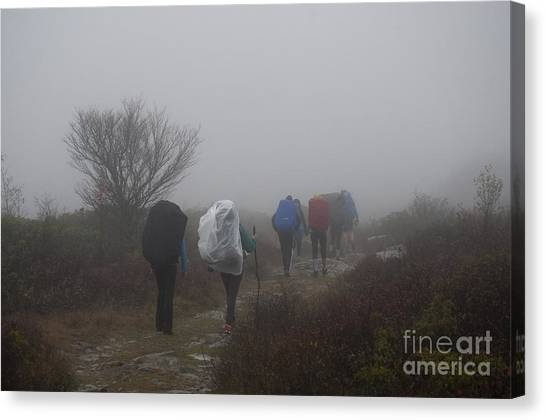 Hikers Going Into The Fog At Dolly Sods Canvas Print by Dan Friend