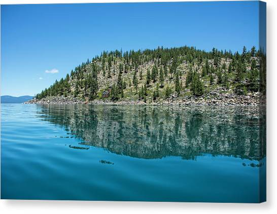 Hillside Reflected On Glassy Water Canvas Print