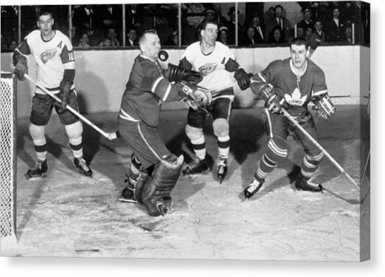 Hockey Players Canvas Print - Hockey Goalie Chin Stops Puck by Underwood Archives