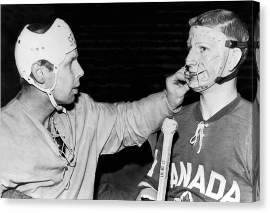 Hockey Players Canvas Print - Hockey Goalie Inspects Mask by Underwood Archives