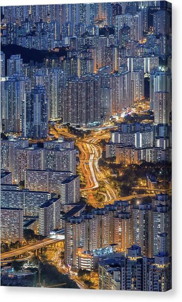 Hong Kong Urban Life Canvas Print by Ratnakorn Piyasirisorost