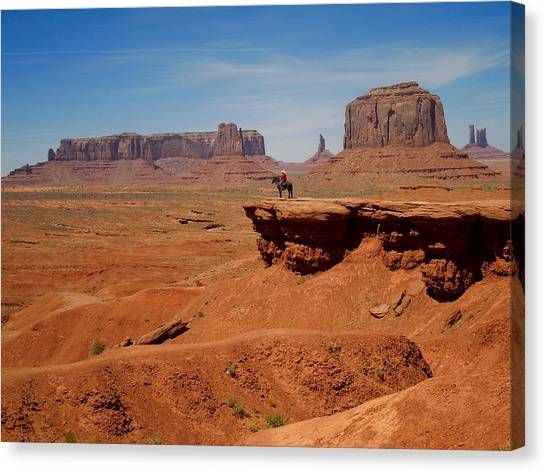 Horse And Rider In Monument Valley Canvas Print