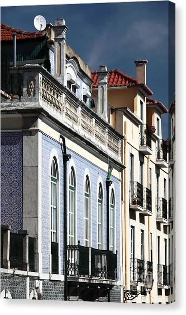 Houses In Alfama Canvas Print by John Rizzuto