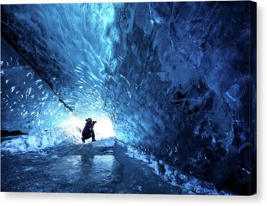 Ice Cave Explorer Canvas Print by Piriya Photography