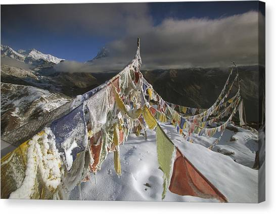 Kangchenjunga Canvas Print - Icy Prayer Flags Himalaya India by Colin Monteath