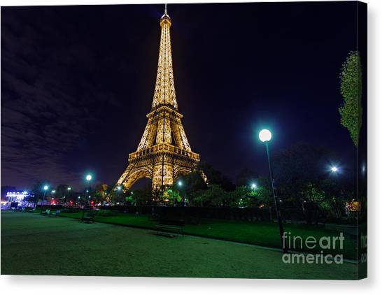 Illuminated Eiffel Tower At Midnight Canvas Print by Rostislav Bychkov