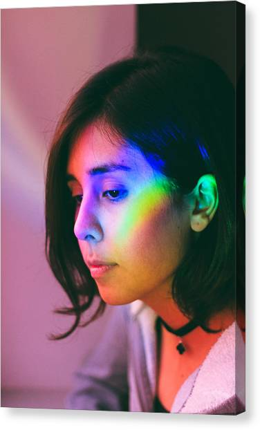 Illuminated Light Falling On Thoughtful Woman Face Canvas Print by Camilo Fuentes Beals / EyeEm
