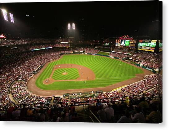 St. Louis Cardinals Canvas Print - In A Night Game And A Light Rain Mist by Panoramic Images