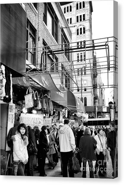 In Chinatown Canvas Print by John Rizzuto