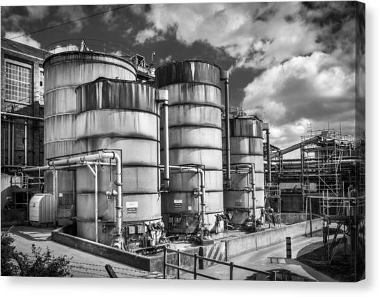 Industrial Silos. Canvas Print by Gary Gillette