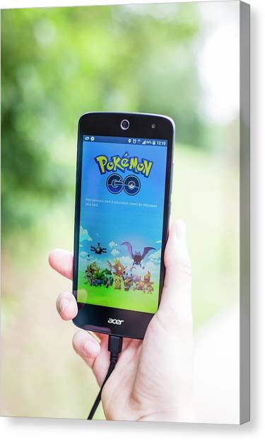 Pokemon Go Canvas Print - Interactive Smartphone Game by Stg/jonas Gilles/reporters/science Photo Library