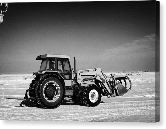 Harsh Conditions Canvas Print - international 5140 tractor with front end loader on frozen field Forget Saskatchewan Canada by Joe Fox