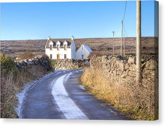 Irish Cottage On Isle Of Inis Mor Canvas Print by Mark Tisdale