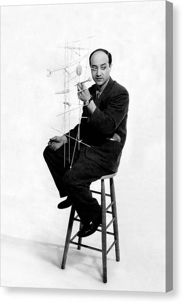 Isamu Noguchi Holding One Of His Structures Canvas Print by Herbert Matter