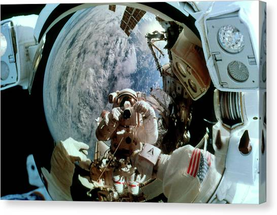 Space Suit Canvas Print - Iss Astronauts by Nasa/science Photo Library