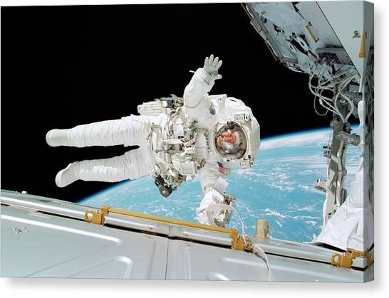 Space Suit Canvas Print - Iss Construction Space Walk by Nasa