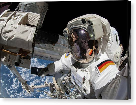 Space Suit Canvas Print - Iss Spacewalk by Nasa