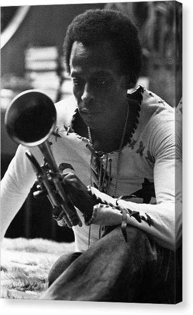 Candids Canvas Print - Jazz Musician Miles Davis Looking At His Trumpet by Mark Patiky