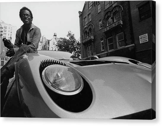 Jazz Musician Miles Davis Sitting On The Hood Canvas Print
