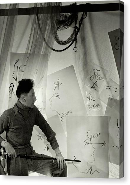 Jean Cocteau With A Cane And Drawings Canvas Print by Cecil Beaton
