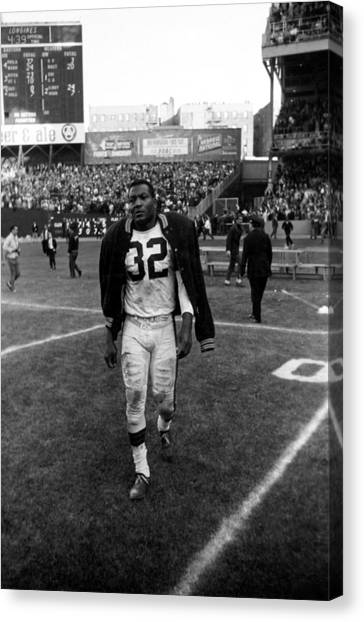 Running Backs Canvas Print - Jim Brown With Coat Over Shoulder Pads by Retro Images Archive