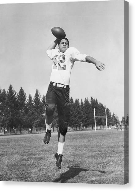 Football Players Canvas Print - Joe Francis Throwing Football by Underwood Archives
