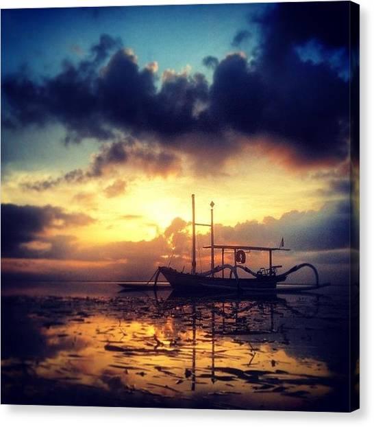 Sunrise Horizon Canvas Print - Jukung traditional Fishing Boat In by Dwi Kresnantaka