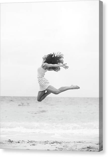 Jumping At The Beach Canvas Print