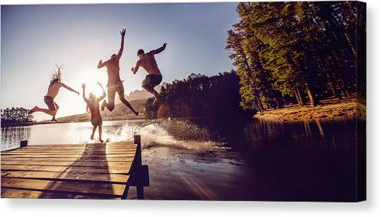 Jumping Into The Water From A Jetty Canvas Print by Wundervisuals