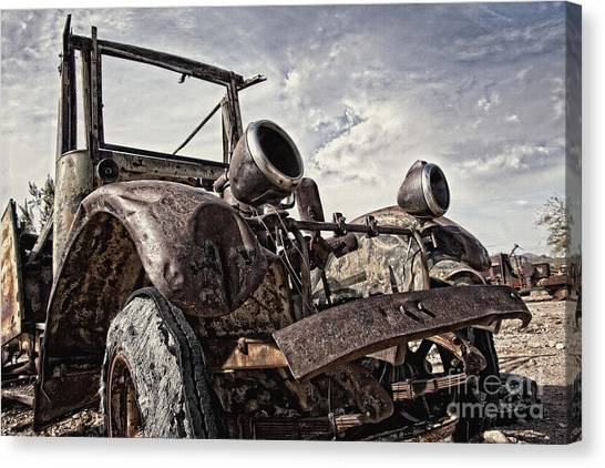 Junk Yard Sentinel Stands  Canvas Print