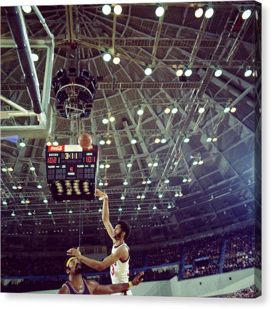 Ucla Canvas Print - Kareem Abdul Jabbar Shooting Quick by Retro Images Archive