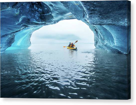 Kayak In Ice Cave Canvas Print by Piriya Photography