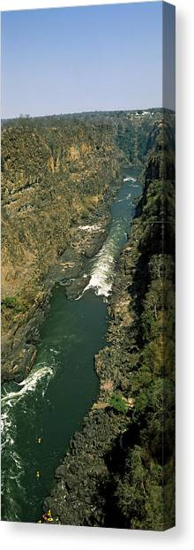 Victoria Falls Canvas Print - Kayakers Paddle Down The Zambezi Gorge by Panoramic Images