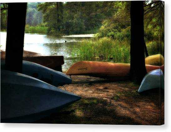 Kayaks On The Shore Canvas Print