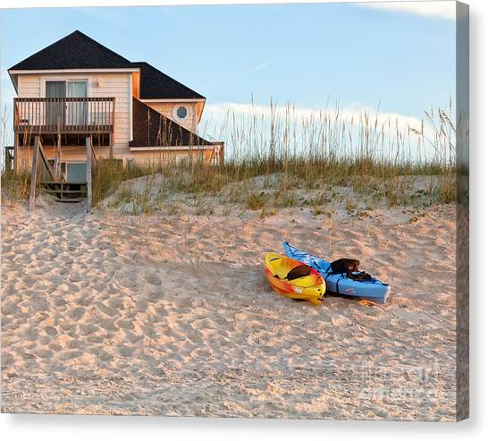 Kayaks Rest On Sand Dune In Morning Sun. Canvas Print