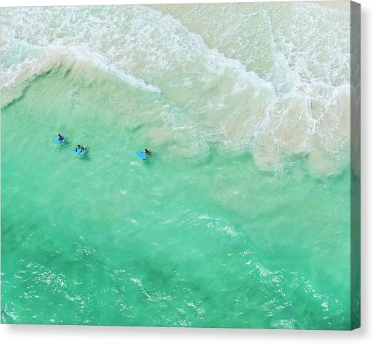 Kids Playing In The Waves On Tropical Canvas Print