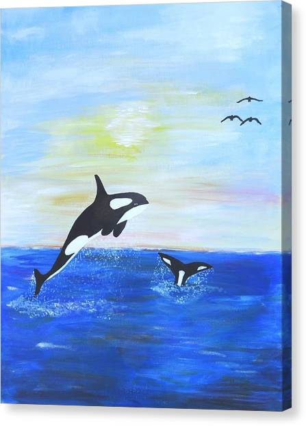 Killer Whales Leaping Canvas Print