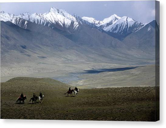 Hindu Kush Canvas Print - Kirghiz Men On Horseback Playing by Beth Wald