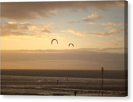 Kites At Sunset Canvas Print by Dave Woodbridge